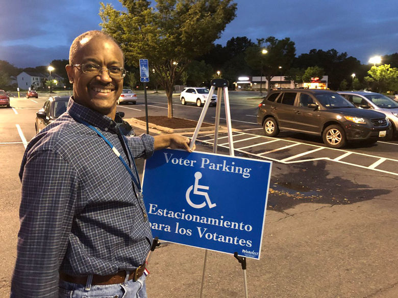 """Precinct 223 chief Alex Turner was out in Reston early Tuesday morning. """"All are welcome,"""" he said. (WTOP/Kristi King)"""