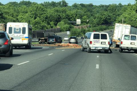 Truck crash on Inner Loop spills bricks across road
