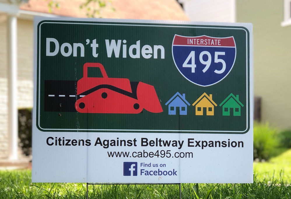 Signs dot the Silver Spring neighborhood of Indian Spring which flanks the Capital Beltway. Neighbors say they worry about the possible impact of expanding the Beltway. (WTOP/Kate Ryan)