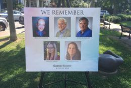 Dozens gathered in Annapolis on Friday to mark the anniversary of the shooting massacre inside the Capital Gazette newsroom, and to honor the five employees slain that day. (WTOP/John Domen)