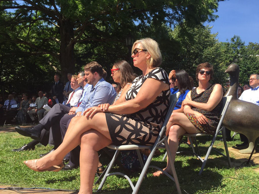 Under the summer sun, loved ones. colleagues and others gathered to honor the victims. (WTOP/John Domen)