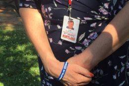 Andrea Chamblee wears her husband's favorite press pass every day. (WTOP/John Domen)