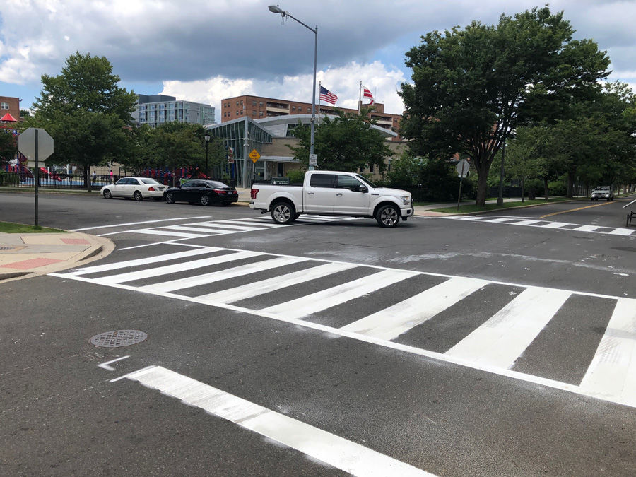 """The new ladder crosswalks consist of a more-reflective material. And with more of that paint on the road, it """"pops out,"""" said DDOT Director Jeff Marootian. (WTOP/Kristi King)"""