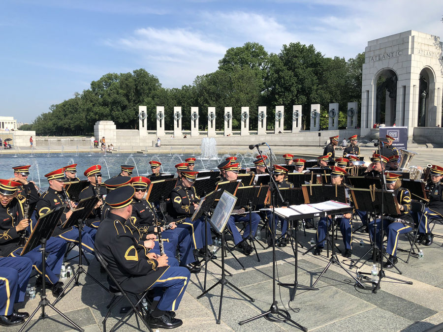 A military band accompanied the proceedings at the World War II Memorial Thursday to mark D-Day's 75th anniversary. (WTOP/John Aaron)