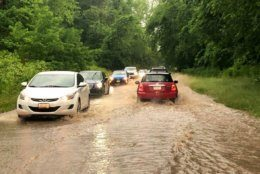High standing water and bobbing hail stones on Clara Barton Parkway near Little Falls on June 2. (WTOP/Dave Dildine)