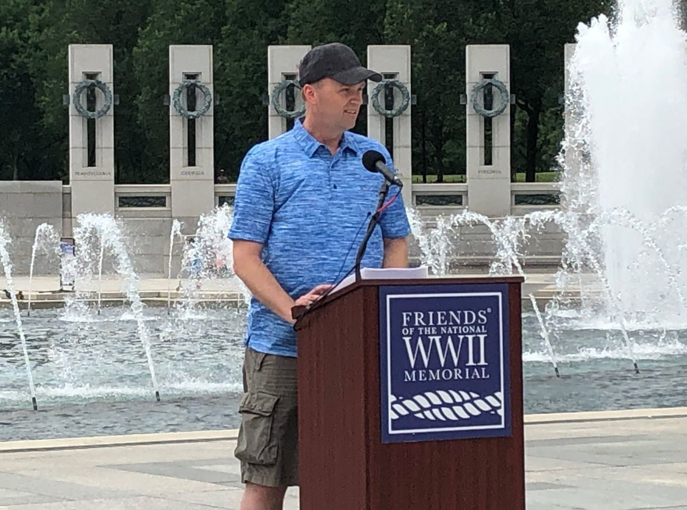Greg Clawson, from Roseville, California, is visiting the D.C. area with his family. When they arrived at the memorial and saw what was going on, Clawson chose to add his voice. (WTOP/Michelle Basch)