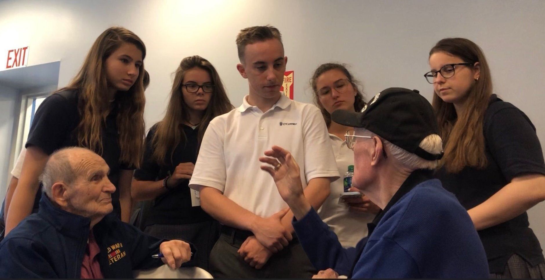 """Liam Kellog, 16, center, says it's """"inspiring"""" to have the chance to hear the stories from the veterans.  (WTOP/Kristi King)"""