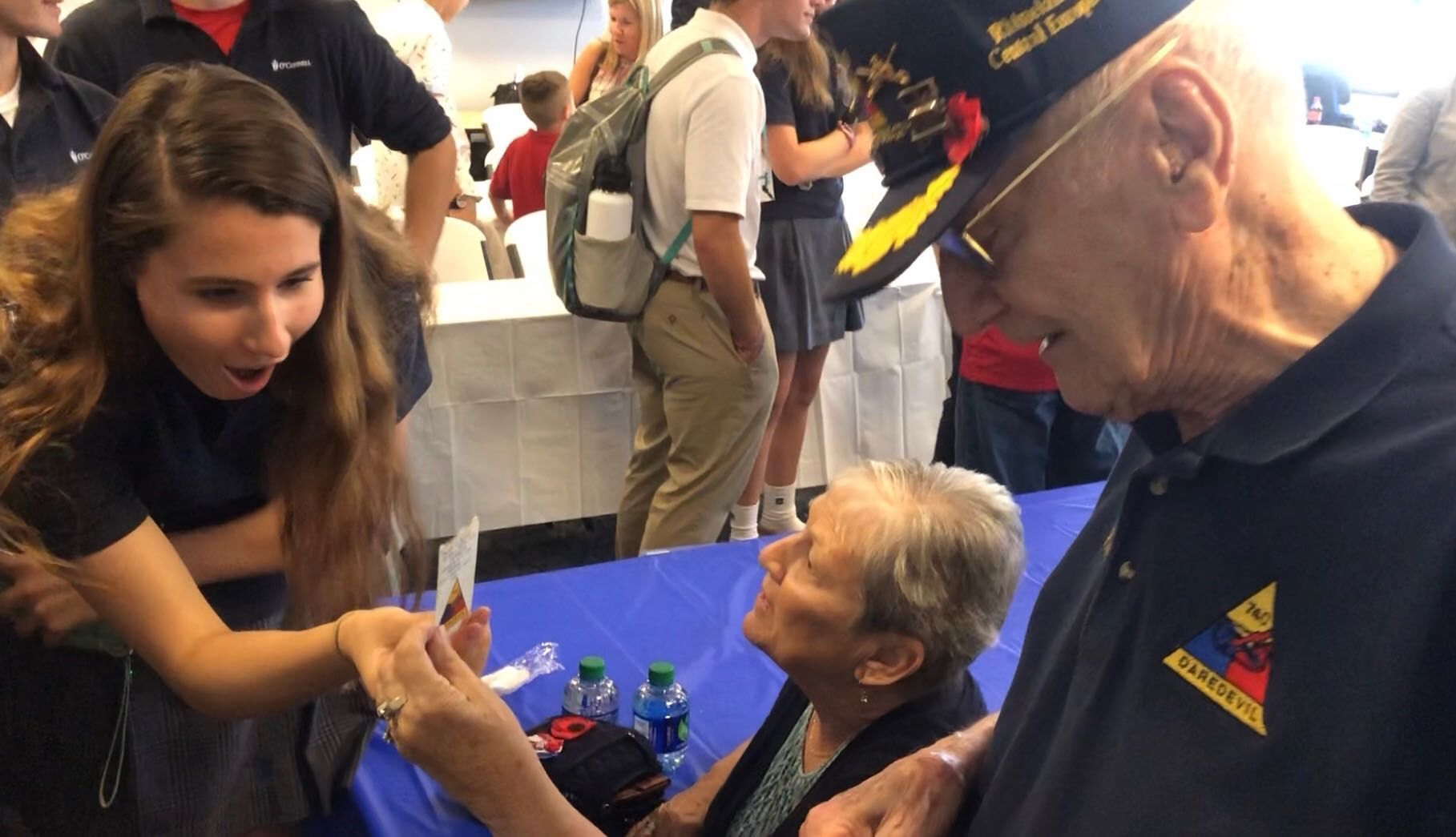 Skye Ferris, 17, visits with veterans who took part during D-Day. (Kristi King)