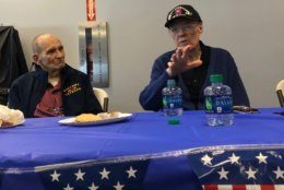 Clifford Stump, 94, of Texas, and Gordon D. Monson, 91, of Minnesota, share their WWII experience with Virginia students. (WTOP/Kristi King)