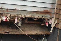 This photo from a Germantown home where a deck collapsed Saturday shows a band board that is practically gone.  (Courtesy Montgomery County Department of Permitting Services)