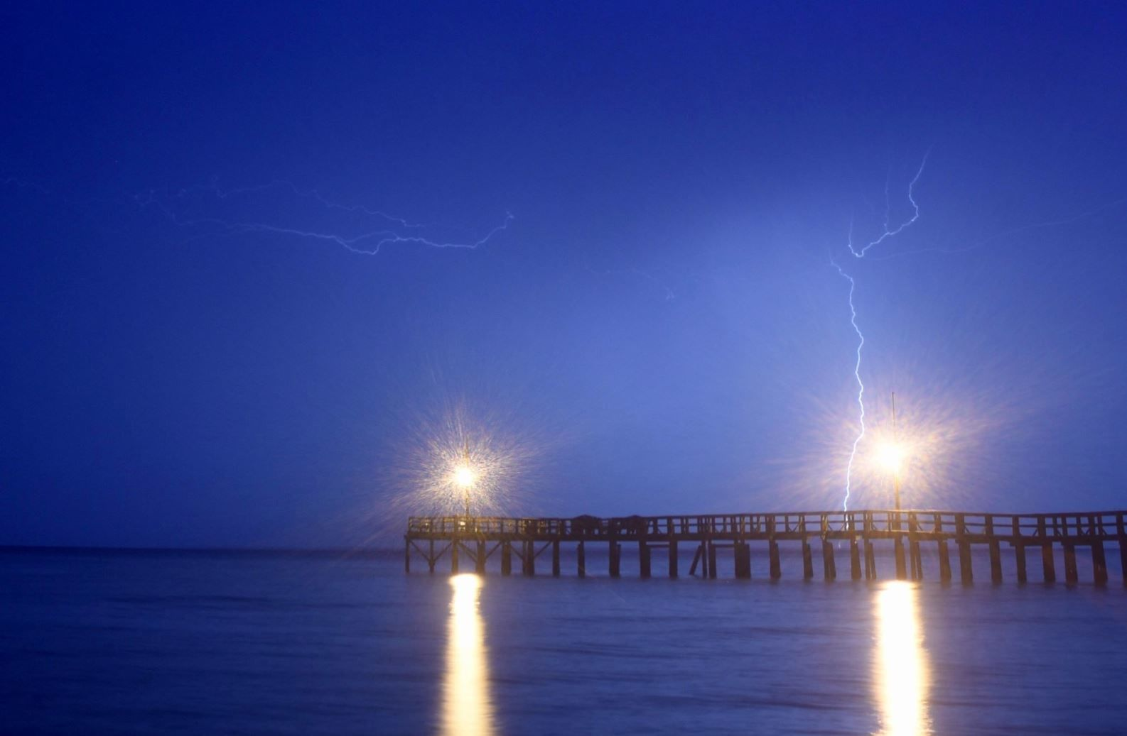 Lightning strikes over the Chesapeake Bay in Calvert County, Maryland, on Monday, June 17, 2019. (WTOP/Dave Dildine)