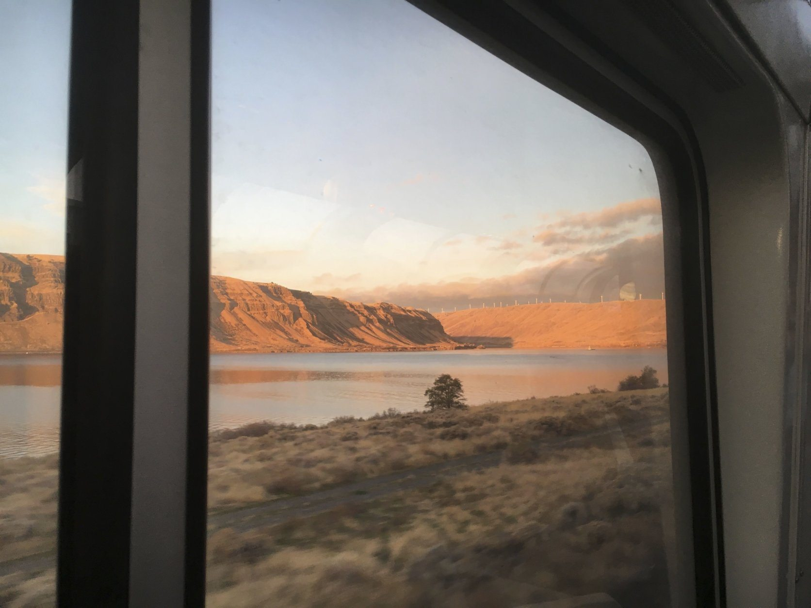 In this Nov. 14, 2017 photo Amtrak's Empire Builder approaches a bend in the Columbia River Gorge. The Empire Builder's section serving Portland, Oregon, travels approximately 55 miles of the gorge, which separates Oregon and Washington. Further east, the train crosses the northern Rockies and the northern Great Plains on its route between Chicago and the Pacific Northwest. (AP Photo/Paul Davenport)