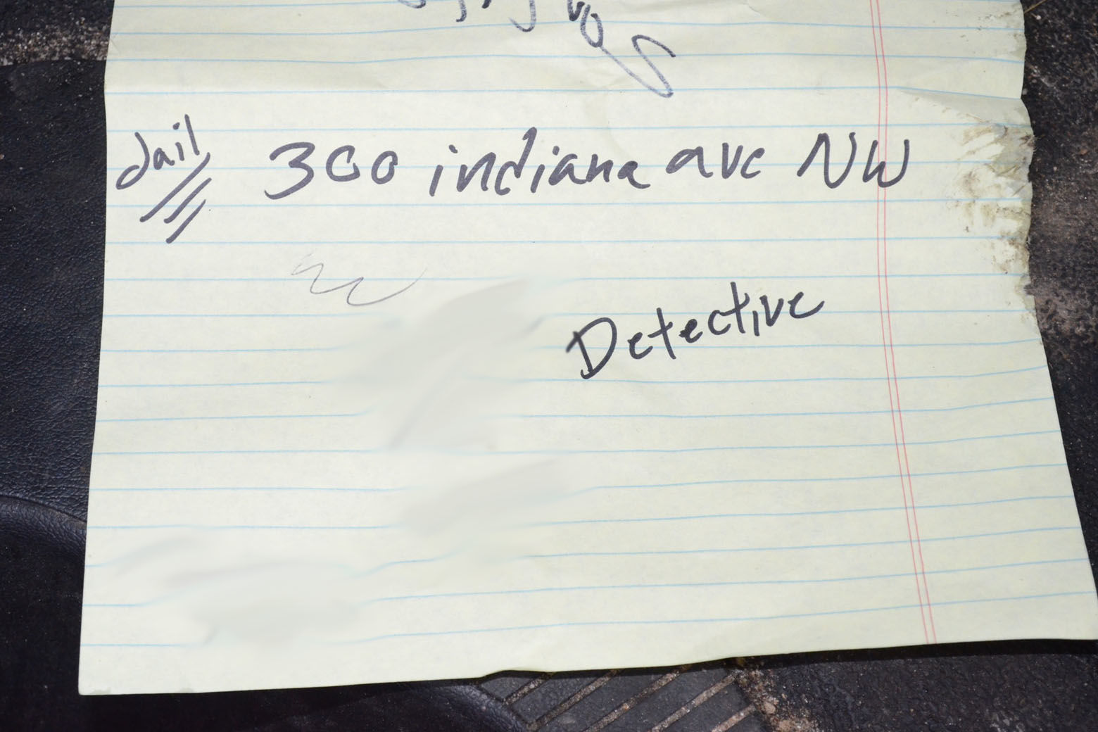 This piece of paper was found by police the night Daron Wint was arrested. His younger brother, Darrell Wint, testified he was on the phone with police to turn Daron in when their vehicles were swarmed by U.S. Marshals. The scrap of paper contains the address for the D.C police headquartersl. A phone number scribbled next to the word detective (blurred out in this photograph) was the phone number for D.C. Det. Jeff Owens, the lead detective investigating the killings of the Savopoulos family and Vera Figueroa.