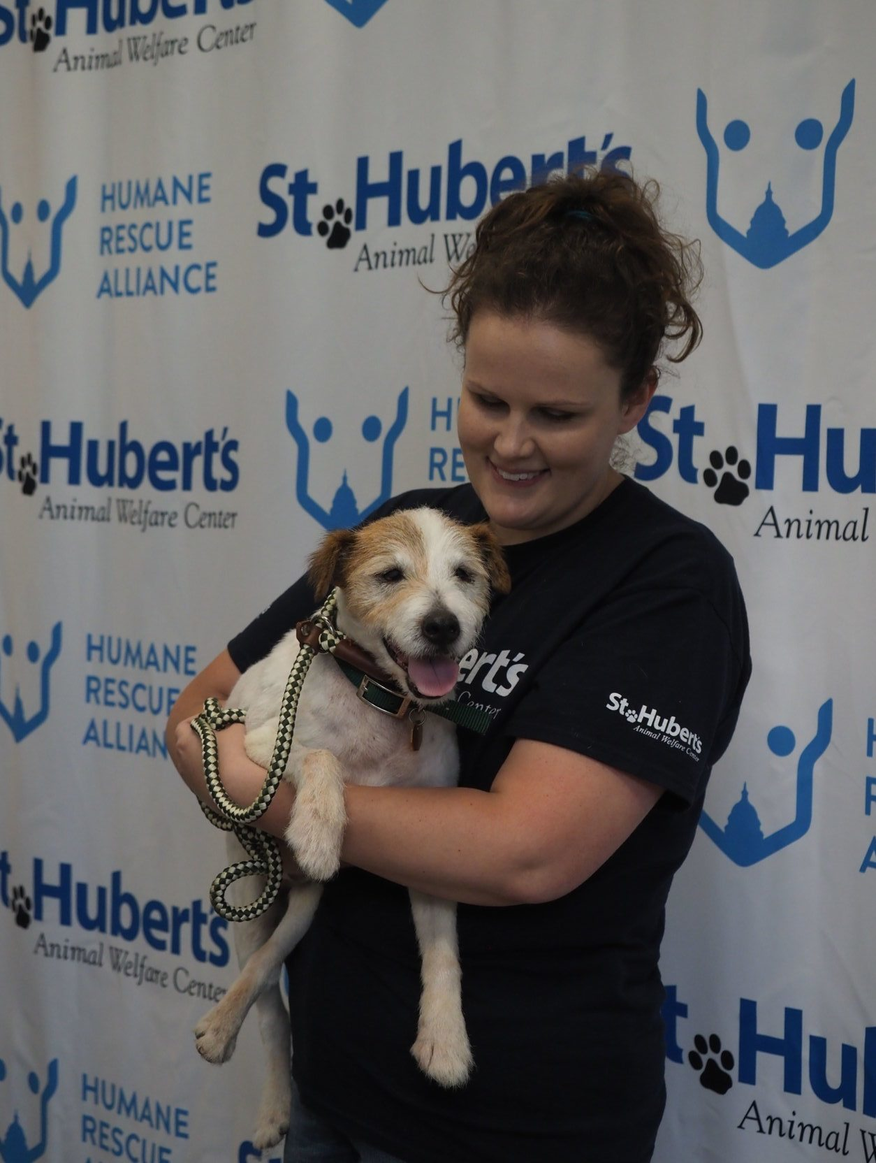 St. Hubert's Animal Welfare staff holding dog