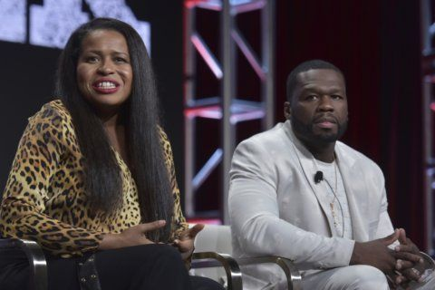 A beaming 50 Cent,  tough questions part of TV critics event