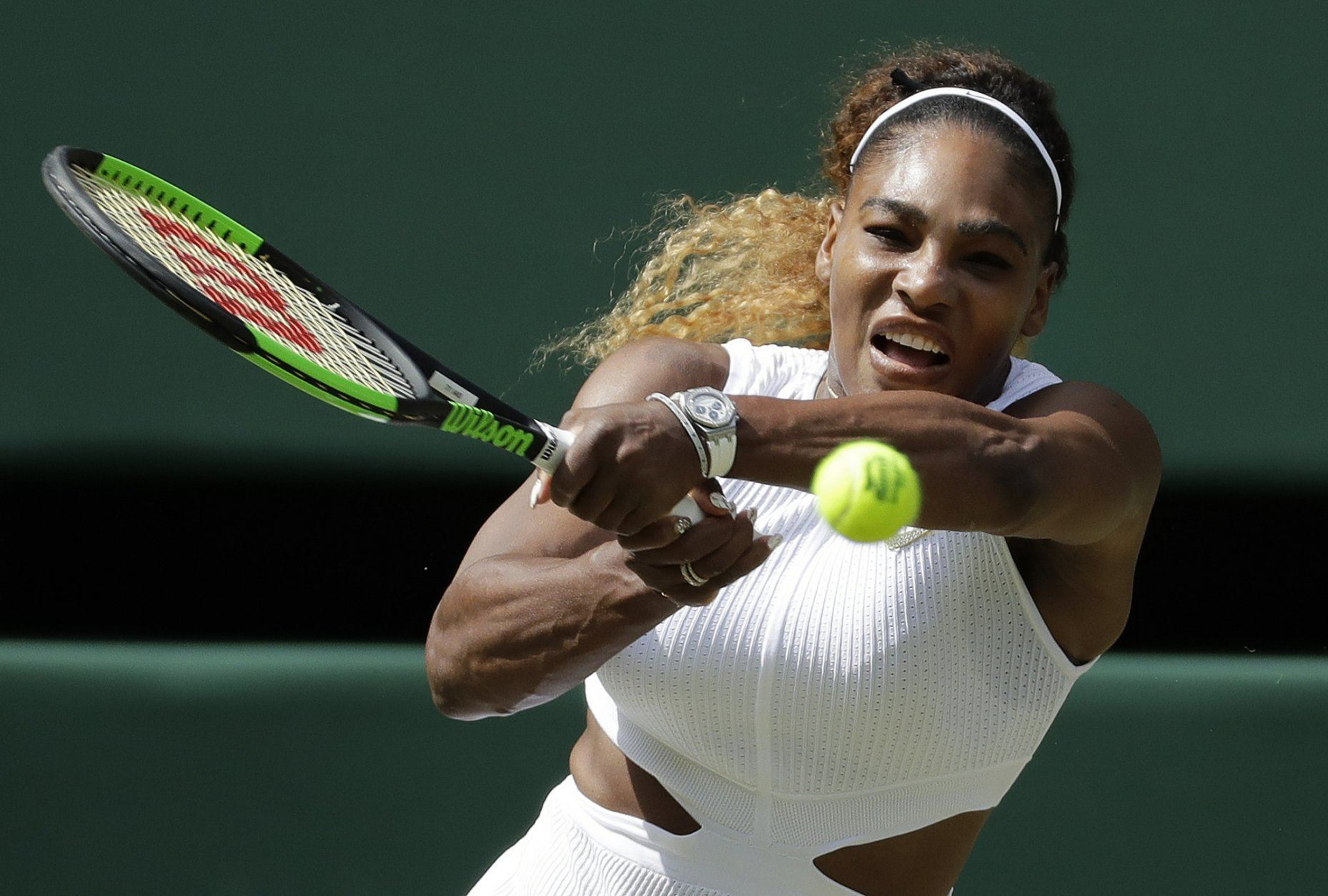 United States' Serena Williams returns to Czech Republic's Barbora Strycova in a Women's semifinal singles match on day ten of the Wimbledon Tennis Championships in London, Thursday, July 11, 2019.