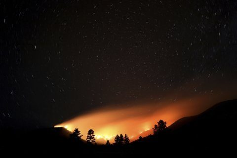 The Latest: Flash flood warning for areas below wildfire