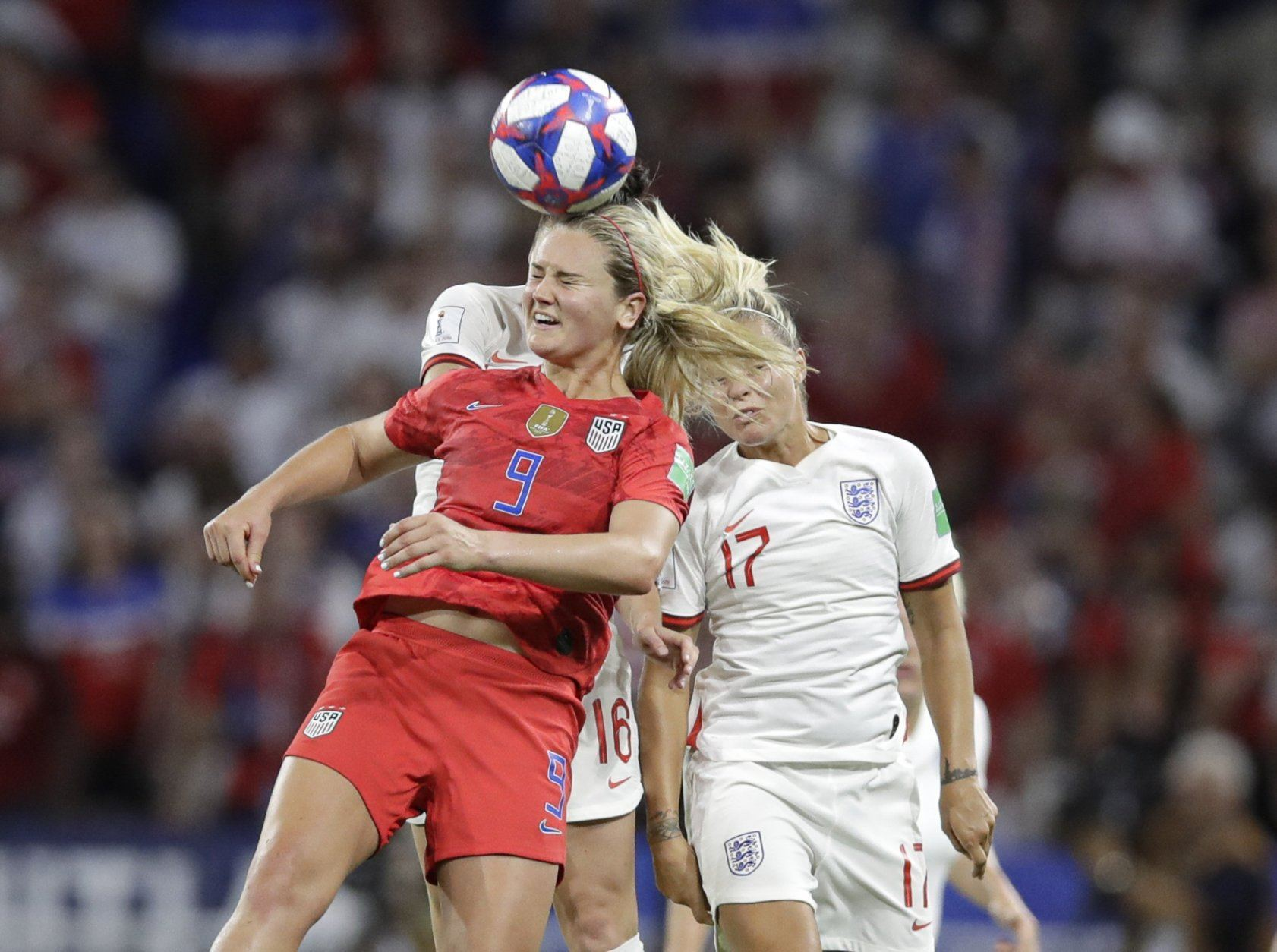 United States' Lindsey Horan, left, jumps for a header with England's Rachel Daly during the Women's World Cup semifinal soccer match between England and the United States, at the Stade de Lyon, outside Lyon, France, Tuesday, July 2, 2019. (AP Photo/Alessandra Tarantino)