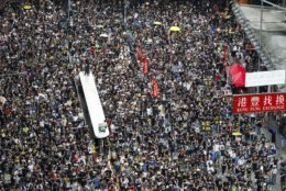 Protesters take part in a march on a street in Hong Kong, Sunday, July 21, 2019. Thousands of Hong Kong protesters marched from a public park to call for an independent investigation into police tactics. (AP Photo/Vincent Yu)