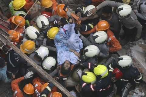 Rescuers look for survivors after building collapse in India