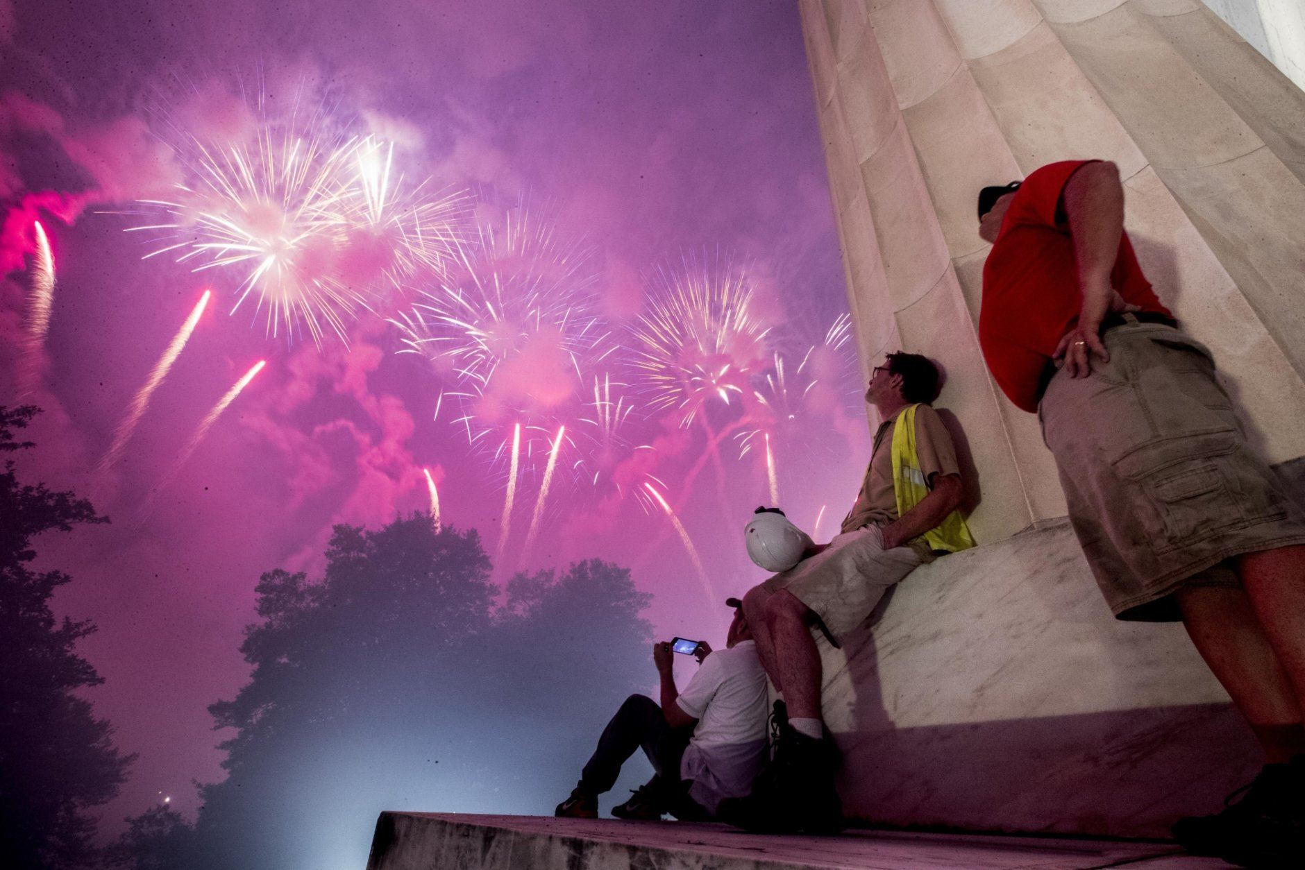 Fireworks seen from the Lincoln Memorial explode over the Potomac River for Independence Day, Thursday, July 4, 2019, in Washington. (AP Photo/Andrew Harnik)
