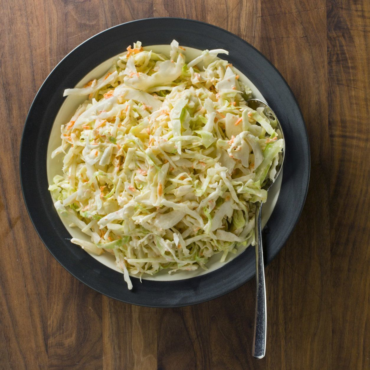 """This undated photo provided by America's Test Kitchen in May 2018 shows creamy buttermilk coleslaw in Brookline, Mass. This recipe appears in the cookbook """"Complete Make-Ahead."""" (Steve Klise/America's Test Kitchen via AP)"""
