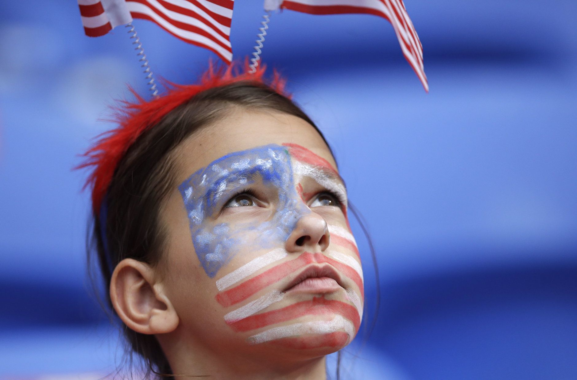 A United States fan with a painted face waits for the start of the Women's World Cup semifinal soccer match between England and the United States, at the Stade de Lyon outside Lyon, France, Tuesday, July 2, 2019. (AP Photo/Alessandra Tarantino)