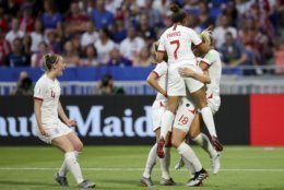 England players celebrate after scoring against United States during the Women's World Cup semifinal soccer match at the Stade de Lyon outside Lyon, France, Tuesday, July 2, 2019. (AP Photo/Francisco Seco)