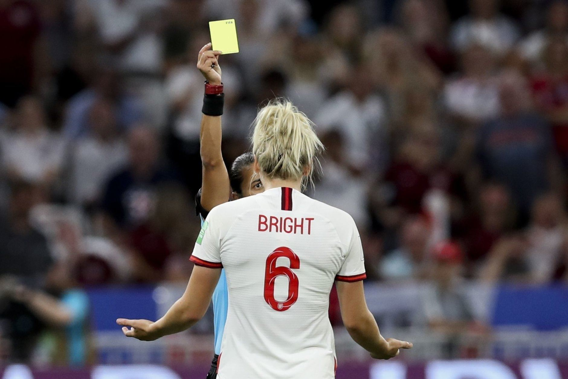 Brazilian referee Edina Alves Batista shows a second yellow card to England's Millie Bright during the Women's World Cup semifinal soccer match between England and the United States, at the Stade de Lyon outside Lyon, France, Tuesday, July 2, 2019. (AP Photo/Francisco Seco)