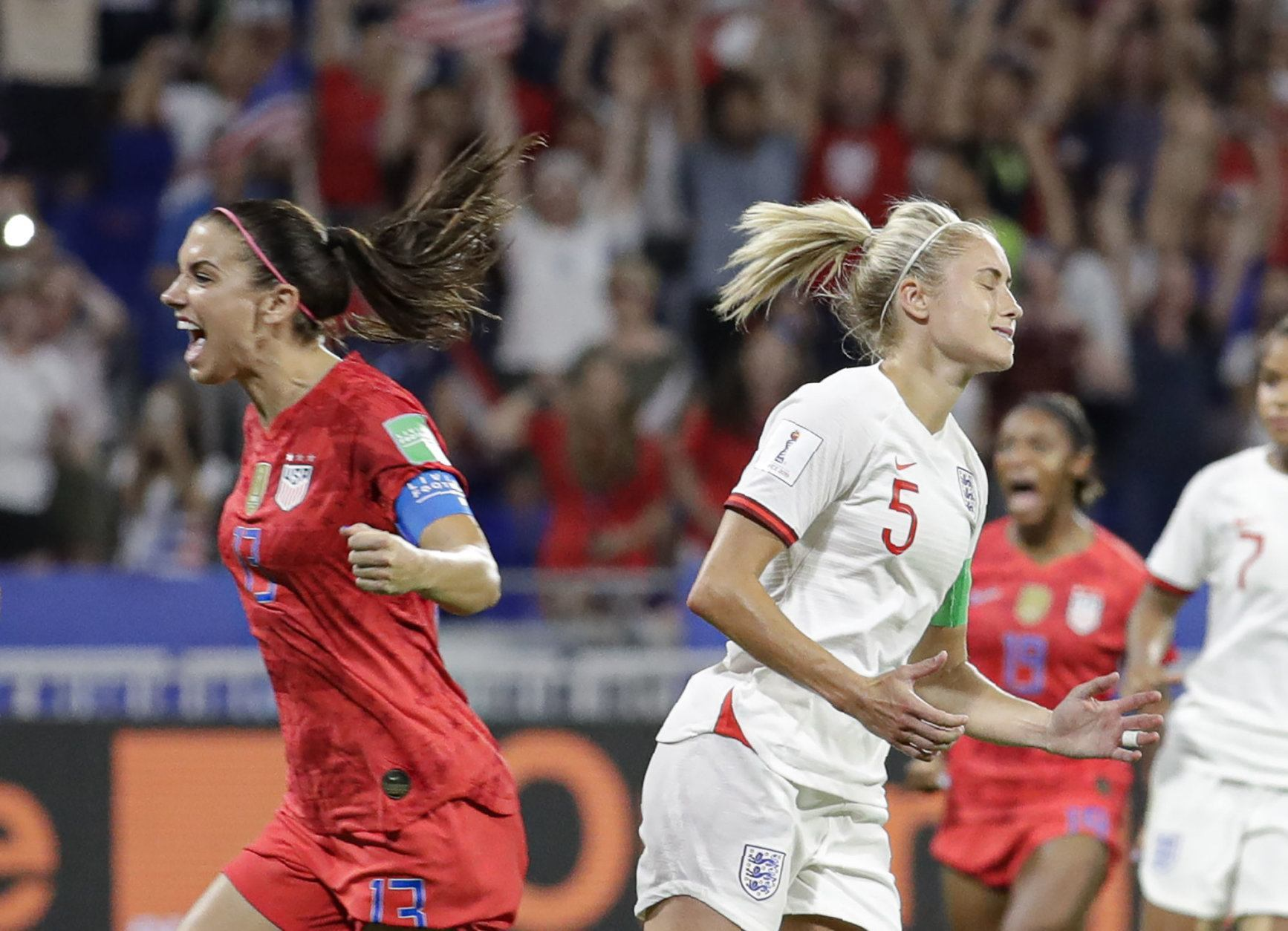 England's Steph Houghton, right, grimaces after failing to score from the penalty spot as United States' Alex Morgan celebrates during the Women's World Cup semifinal soccer match between England and the United States, at the Stade de Lyon, outside Lyon, France, Tuesday, July 2, 2019. (AP Photo/Alessandra Tarantino)