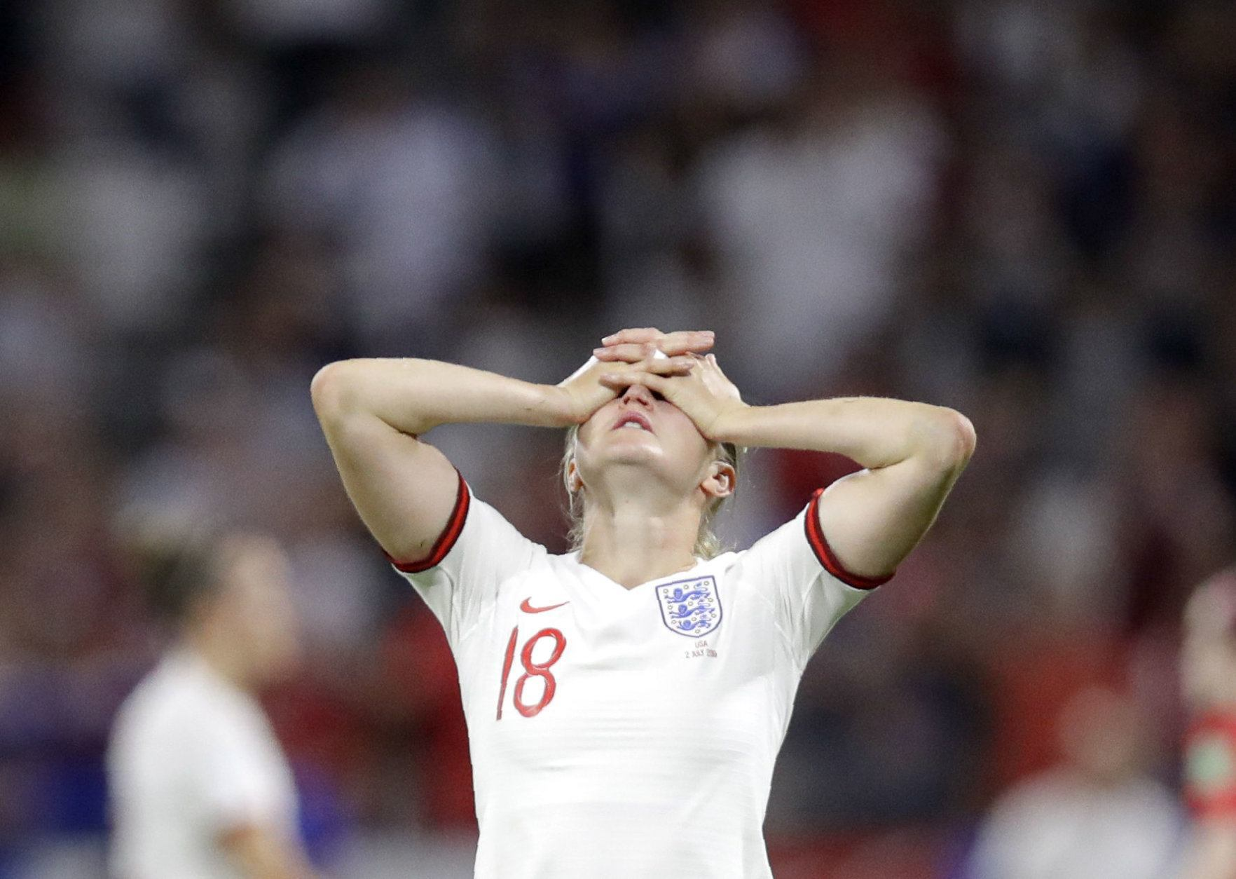 England's Ellen White covers her face at the end of the Women's World Cup semifinal soccer match between England and the United States, at the Stade de Lyon, outside Lyon, France, Tuesday, July 2, 2019. (AP Photo/Alessandra Tarantino)