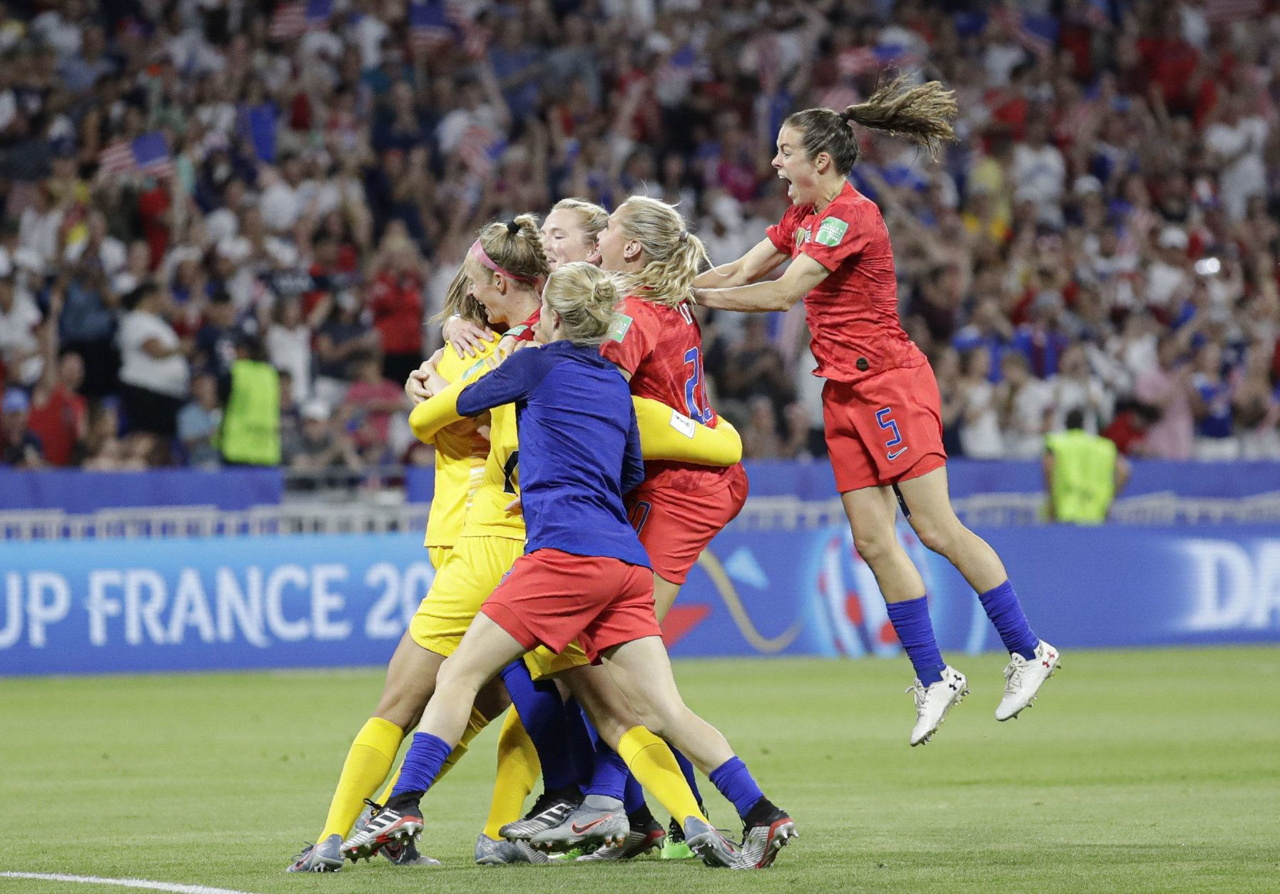 United States' players celebrate at the end of the Women's World Cup semifinal soccer match between England and the United States, at the Stade de Lyon, outside Lyon, France, Tuesday, July 2, 2019. (AP Photo/Alessandra Tarantino)