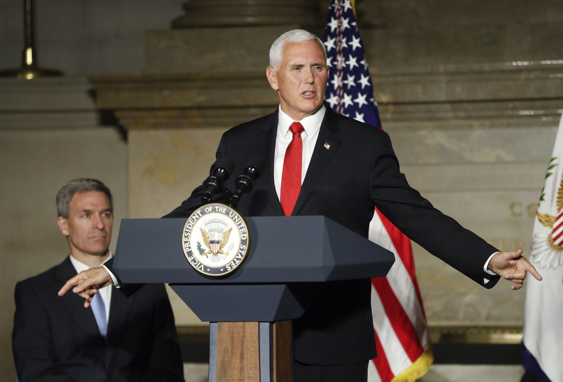 Vice President Mike Pence speaks at a naturalization ceremony for new naturalized citizens in celebration of Independence Day at the National Archives in Washington, Thursday, July 4, 2019. Also at the event is Acting Director, US Immigration and Immigration Services, Kenneth T. Cuccinelli, left seated. (AP Photo/Pablo Martinez Monsivais)
