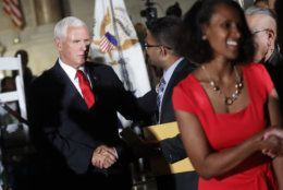 Vice President Mike Pence, left, greets new naturalized citizens at a naturalization ceremony in celebration of Independence Day at the National Archives in Washington, Thursday, July 4, 2019. (AP Photo/Pablo Martinez Monsivais)