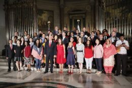 Vice President Mike Pence, center, his wife Karen Pence, pose for a group photo with new naturalized citizens following a naturalization ceremony in celebration of Independence Day at the National Archives in Washington, Thursday, July 4, 2019. Standing behind the Vice President are Secretary of Transportation Elaine Chao and Acting Director, US Immigration and Immigration Services, Kenneth T. Cuccinelli. (AP Photo/Pablo Martinez Monsivais)
