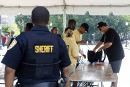 Security guards check bags at a checkpoint before Independence Day celebrations, Thursday, July 4, 2019, on the National Mall in Washington. (AP Photo/Patrick Semansky)