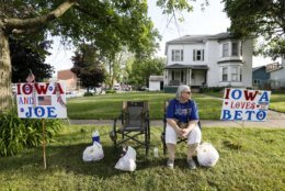 Marva Reece, of Winthrop, Iowa, waits for Democratic presidential candidates Joe Biden and Beto O'Rourke to arrive at the Independence Fourth of July parade, Thursday, July 4, 2019, in Independence, Iowa. (AP Photo/Charlie Neibergall)