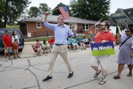 Democratic presidential candidate New York Mayor Bill DeBlasio walks in the Independence Fourth of July parade, Thursday, July 4, 2019, in Independence, Iowa. (AP Photo/Charlie Neibergall)