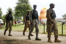 Members of the District of Columbia National Guard walk near a Baby Trump balloon before Independence Day celebrations, Thursday, July 4, 2019, on the National Mall in Washington. (AP Photo/Patrick Semansky)