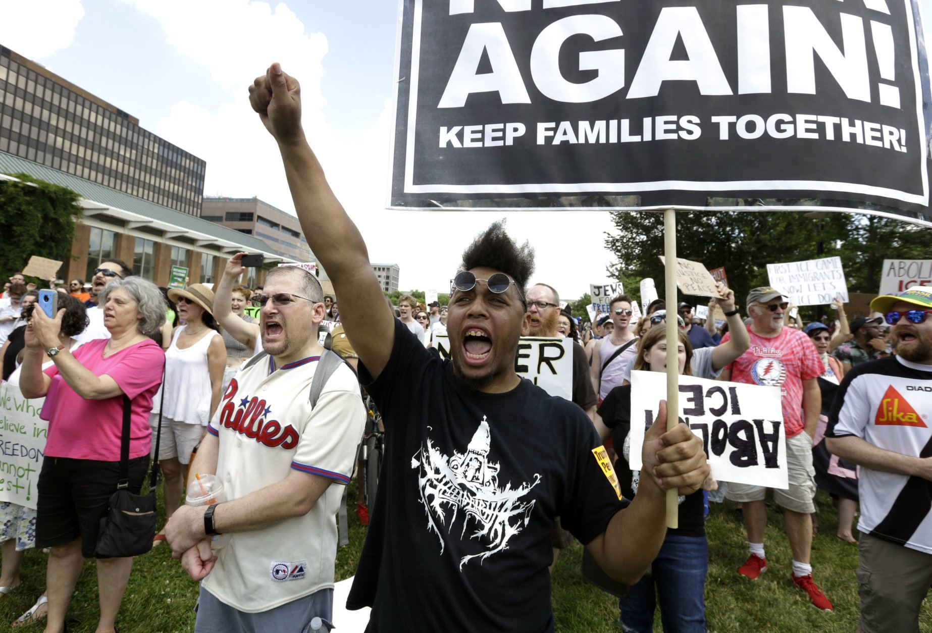 "Protestors assembled by a majority Jewish group called ""Never Again Is Now"" demonstrate near Independence Hall Thursday, July 4, 2019, in Philadelphia. Hundreds gathered during the city's traditional Fourth of July parade to protest the treatment of immigrants and asylum seekers. (AP Photo/Jacqueline Larma)"