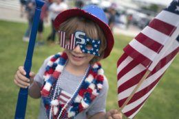 Micah Blume, 8, arrives dressed in American flag glasses for the Santa Monica Fourth of July parade Thursday, July 4, 2019 in Santa Monica, Calif. (AP Photo/Richard Vogel)