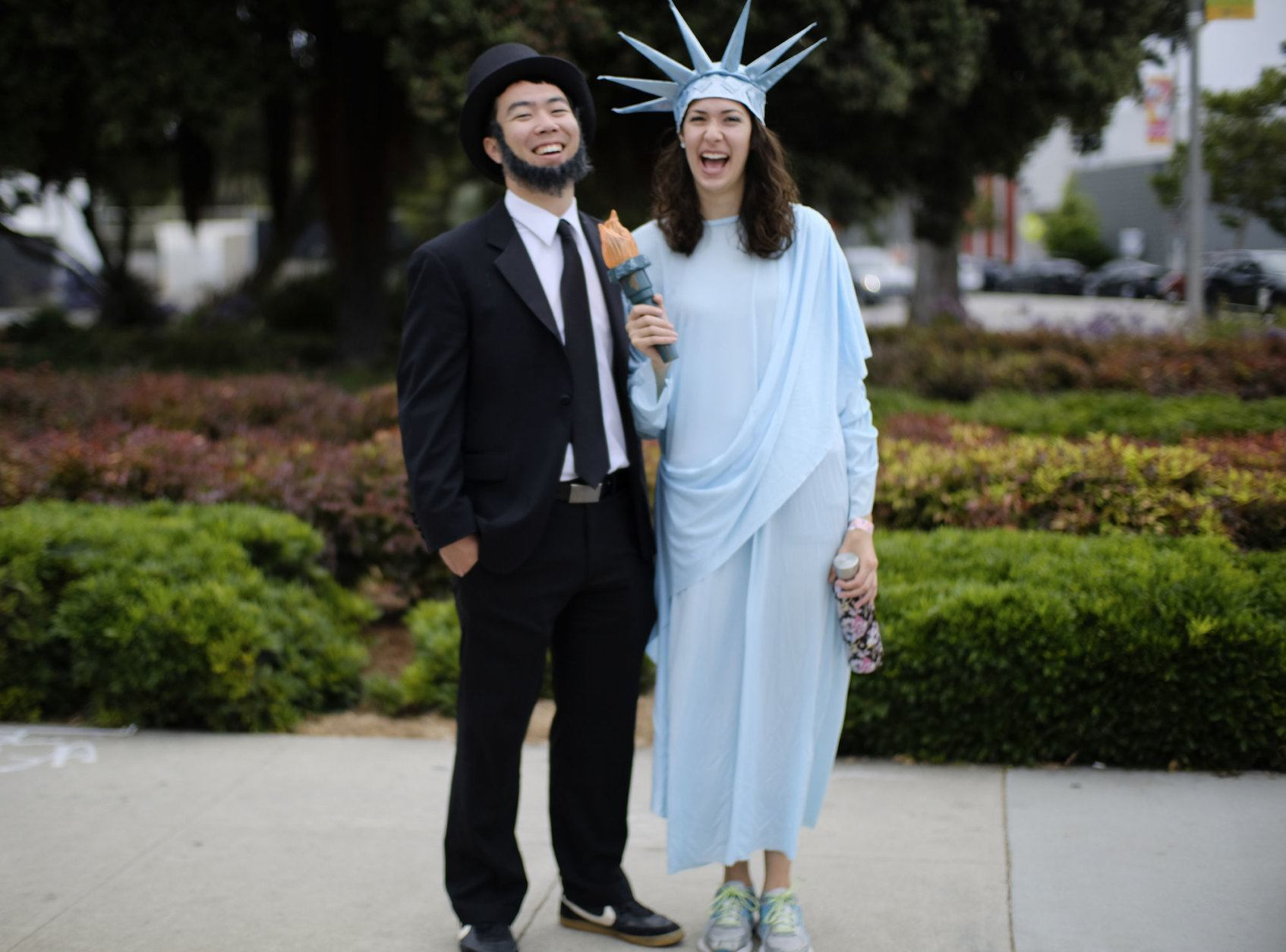 Christian Tomita, left and Erin Wells arrive dressed as Abraham Lincoln and Lady Liberty to participate in the Santa Monica Fourth of July parade Thursday, July 4, 2019 in Santa Monica, Calif. (AP Photo/Richard Vogel)