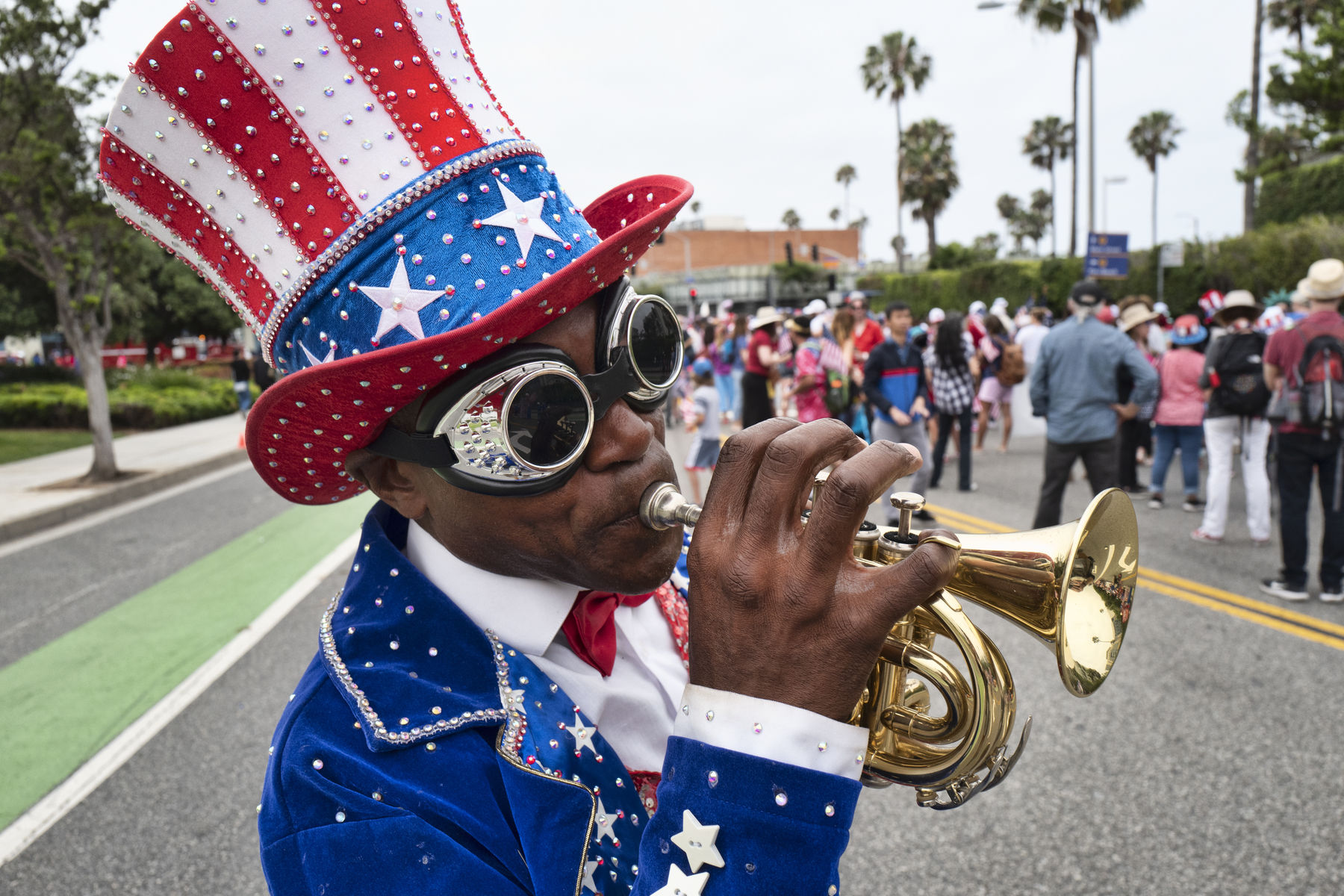A trumpeter who went only by the name Lenny plays a tune during the Santa Monica Fourth of July parade Thursday, July 4, 2019 in Santa Monica, Calif. (AP Photo/Richard Vogel)