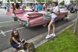 Classic cars and participants wait on the street to take part in the Fourth of July parade in Santa Monica, Calif., on Thursday, July 4, 2019. (AP Photo/Richard Vogel)