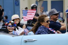 Sophie Barba, 8, left, joins her family in their classic car to celebrate the nation's birthday during the Santa Monica Fourth of July Parade in Santa Monica, Calif., on Thursday, July 4, 2019 in Santa Monica, Calif. (AP Photo/Richard Vogel)