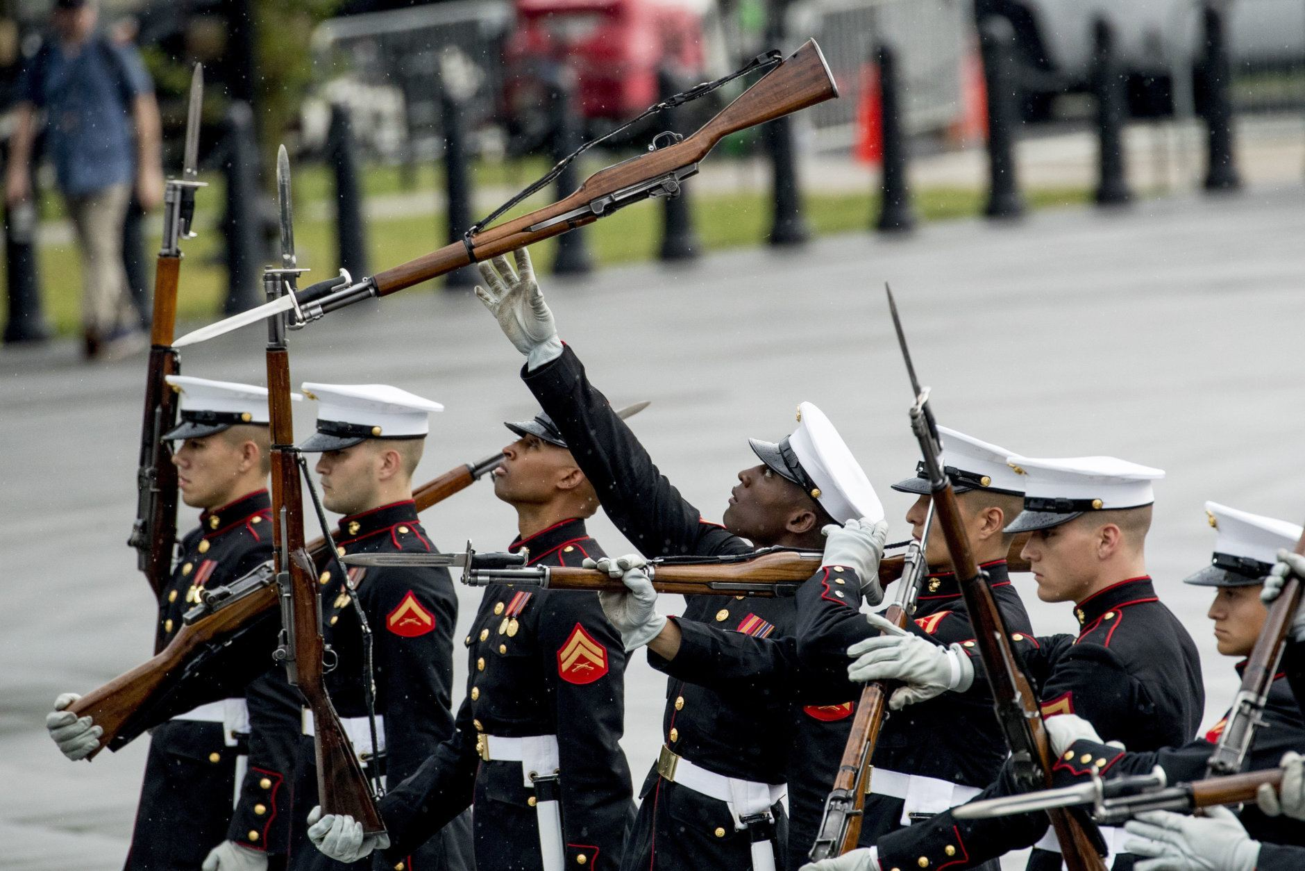 """The Marine Silent Drill Team Performs at President Donald Trump's 'Salute to America' event honoring service branches on Independence Day, Thursday, July 4, 2019, in Washington. President Donald Trump is promising military tanks along with """"Incredible Flyovers & biggest ever Fireworks!"""" for the Fourth of July. (AP Photo/Andrew Harnik)"""