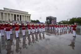 The U.S. Marine Corps Drum and Bugle Corps performs in the rain during an Independence Day celebration in front of the Lincoln Memorial, Thursday, July 4, 2019, in Washington. (AP Photo/Alex Brandon)