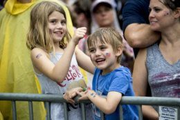 """Children play as they arrive for President Donald Trump's 'Salute to America' event honoring service branches on Independence Day, Thursday, July 4, 2019, in Washington. President Donald Trump is promising military tanks along with """"Incredible Flyovers & biggest ever Fireworks!"""" for the Fourth of July. (AP Photo/Andrew Harnik)"""