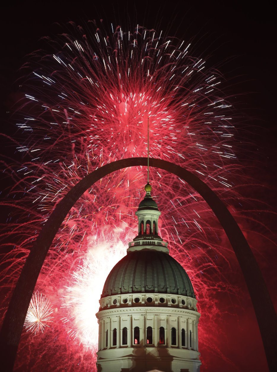 Fireworks light up the night sky over the Gateway Arch and Old Courthouse as part of an Independence Day celebration Thursday, July 4, 2019, in St. Louis. (AP Photo/Jeff Roberson)
