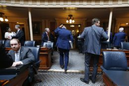 House Speaker Kirk Cox, R-Colonial Heights, center, leaves the House chambers after a special session on gun issues at the state Capitol in Richmond, Va., Tuesday, July 9, 2019. Gov. Northam called a special session of the General Assembly to consider gun legislation in light of the Virginia Beach Shootings both chambers voted to adjourn until Nov. 18. (AP Photo/Steve Helber)